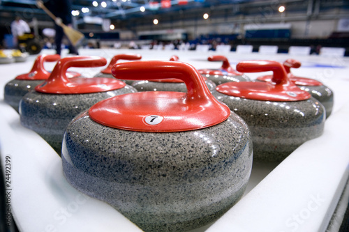 Canvas Group of curling rocks on ice