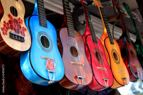 Photo Stands Music store bright colorful guitars for sale