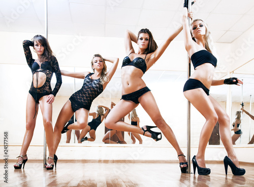 Foto op Canvas Dance School Four young sexy pole dance women