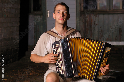 button accordion playing evening serenade Canvas Print
