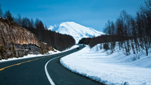 Road Towards A Snow Capped Mou...