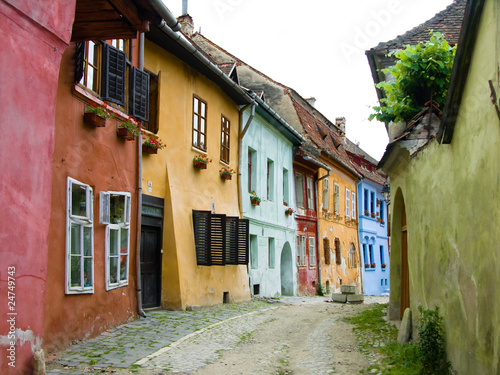 Canvas Prints Narrow alley Sighisoara medieval street, Transylvania in Romania