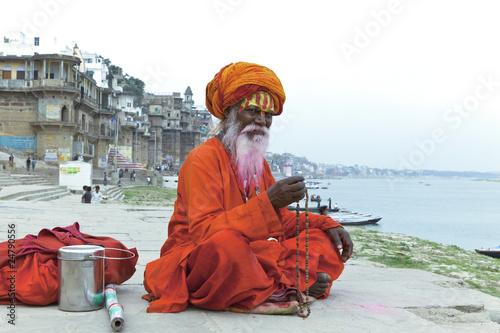 Old Sadhu at the ghats in Varanasi, India. Canvas Print