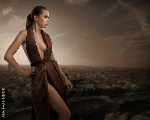 Sexy young beauty posing over urban background