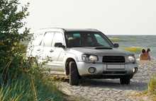SUV Stands On The Beach On The...
