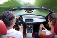 Man And Woman Driving Converti...