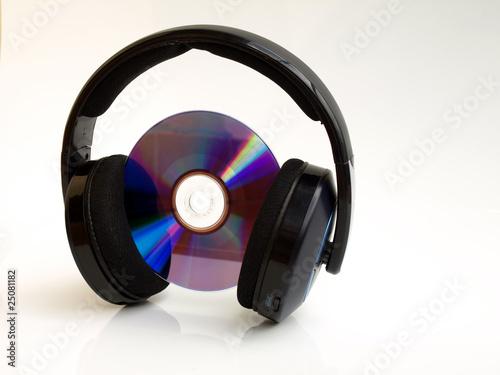 Obraz słuchawki bezprzewodowe z płytą - fototapety do salonu
