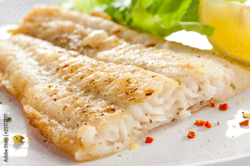 Fotografie, Tablou Fish dish - fried fish fillet with vegetables