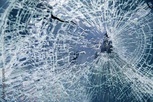 Leinwand Poster Broken car windshield. Tint blue