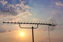 TV Antenna On Cloudy Sky Backg...