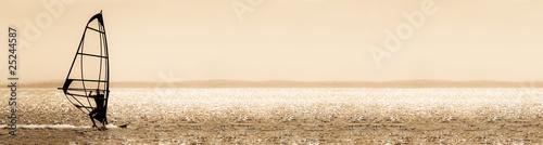 Photo  sepia toned windsurfer panorama