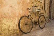 Old Bicycle At A Wall