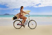 Teenage Girl With Surfboard And Bicycle On Kailua Beach
