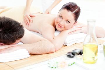 Obraz na płótnie Canvas Caucasian young couple receiving a back massage