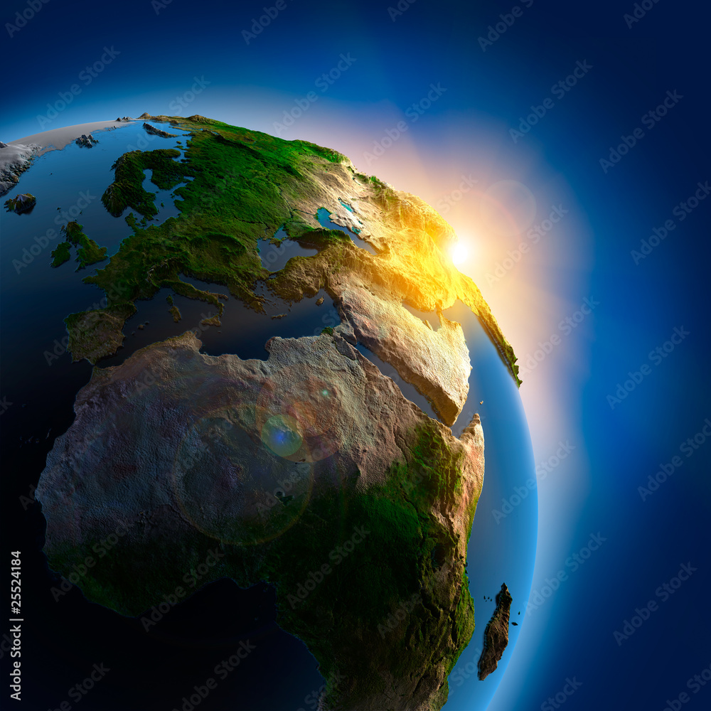 Fototapeta Sunrise over the Earth in outer space
