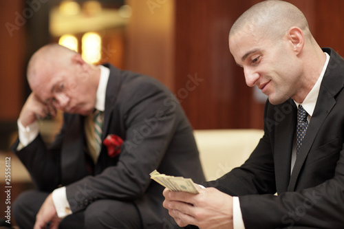 Fotografia, Obraz  Successful businessman counting his money