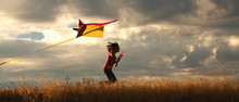 Girl Flying A Kite.