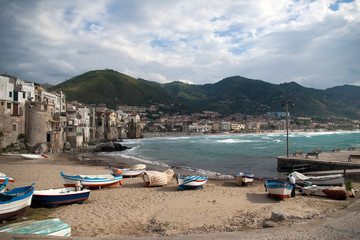 Fototapeta na wymiar Beach in Cefalu, popular touristic village at the island of Sici