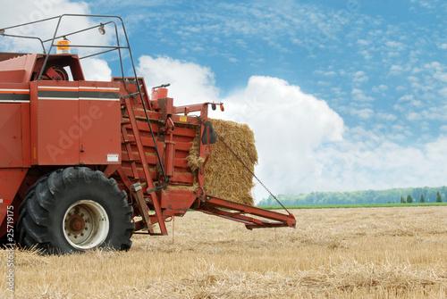 hay baler in the field Wallpaper Mural
