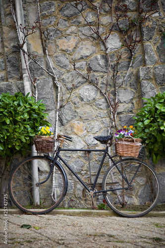 Deurstickers Fiets Vintage bicycle with bunches of flowers