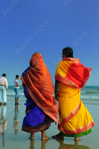 Fotografie, Obraz Colorfull Indian woman with sari on a beach in Orissa, India
