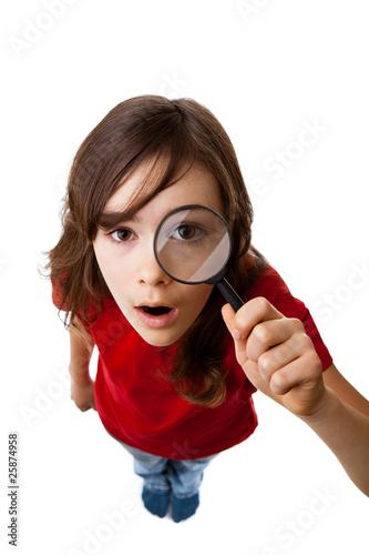 Fotografie, Tablou  Girl holding magnifying glass isolated on white