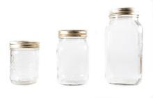 Three Glass Mason Jars On An I...