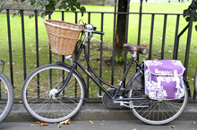 A Lady's Bike With A Basket And Pannier Bags
