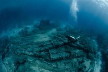 Female Scuba Diver Over Ship W...