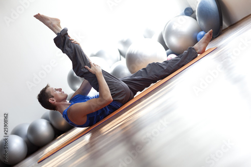 Photo  fusion of mind and body - man practicing pilates