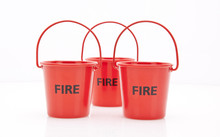 A Row Of Three Red Fire Buckets