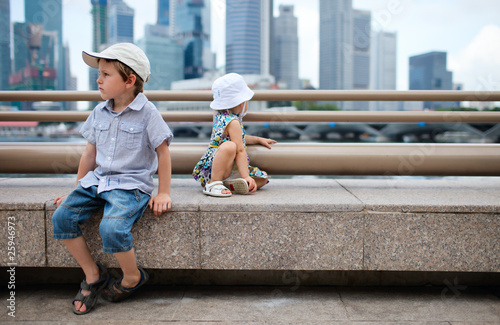 Photo  Two kids at city