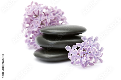 Foto op Canvas Lilac massage stones and lilac flowers