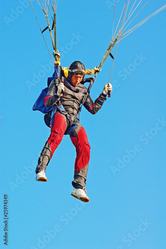 Fotografie, Obraz  The young parachutist in air