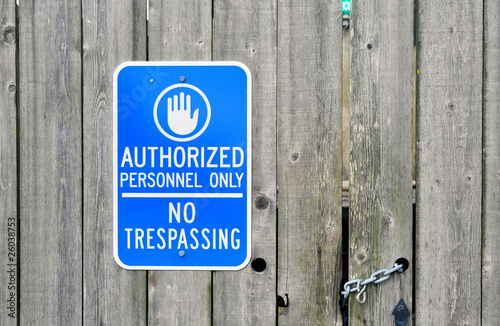 Fotografie, Obraz  Authorized Personnel Only sign on a chained old wooden fence.