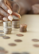 African Woman Staking Quarters