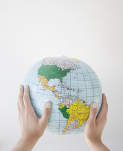 Woman Holding Inflatable Globe