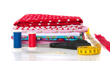 Colorful Modern Cotton Fabrics With Sewing Stuff Isolated On Whi
