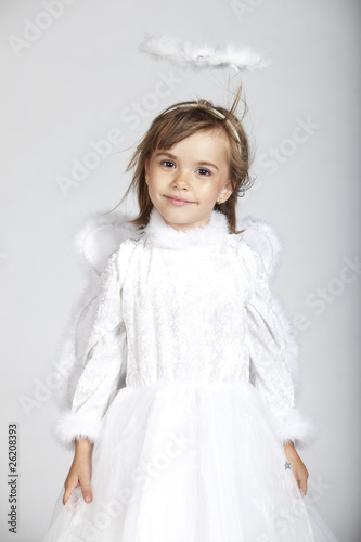 Cute little girl dressed as an angel with white dress and halo Canvas Print