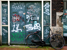 Bicycle And Graffiti In Amster...