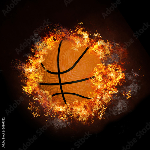 Photo  Basketball on hot fire smoke with black background