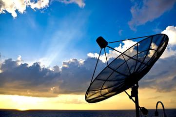 satellite dish silhoette on sunset background