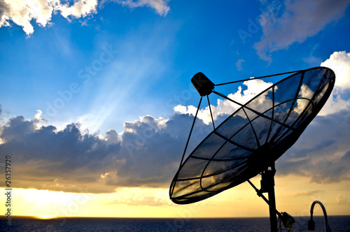 Valokuva  satellite dish silhoette on sunset background