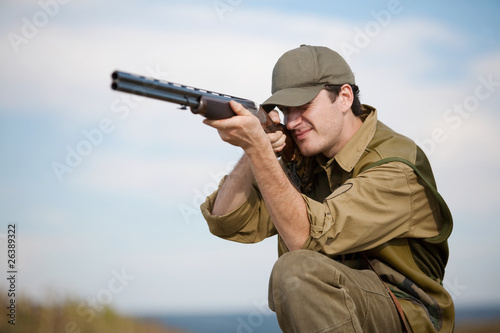 Fotografie, Obraz  Hunter aiming at the hunt during a hunting party