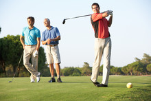 Group Of Male Golfers Teeing O...