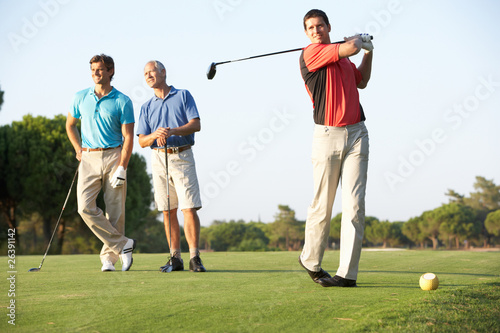 Deurstickers Golf Group Of Male Golfers Teeing Off On Golf Course