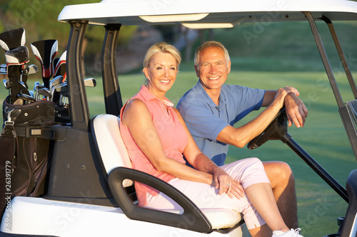 Deurstickers Golf Senior Couple Riding In Golf Buggy On Golf Course