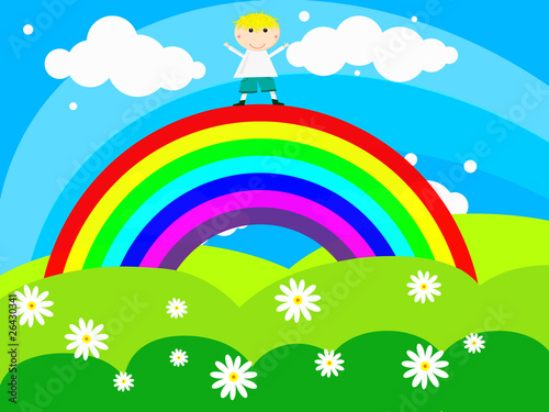 Printed kitchen splashbacks Rainbow Cheerful boy stands on a rainbow