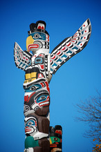 A Colorful Totem Pole In Stanley Park, Vancouver.