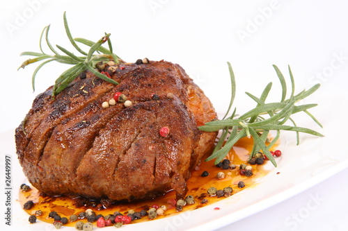 Fotografie, Obraz  Roast pork with rosemary and some colorful peppercorns